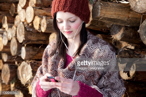 139946560-young-girl-listening-to-mp3-player-gettyimages.jpg