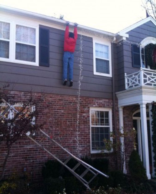 christmas-lights-man-hanging.jpg
